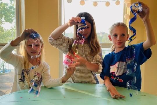 Cindy's daughters Emma, Bella, and Grace give a conservation craft tutorial.